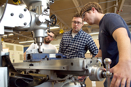 Machining instructor and students in the lab